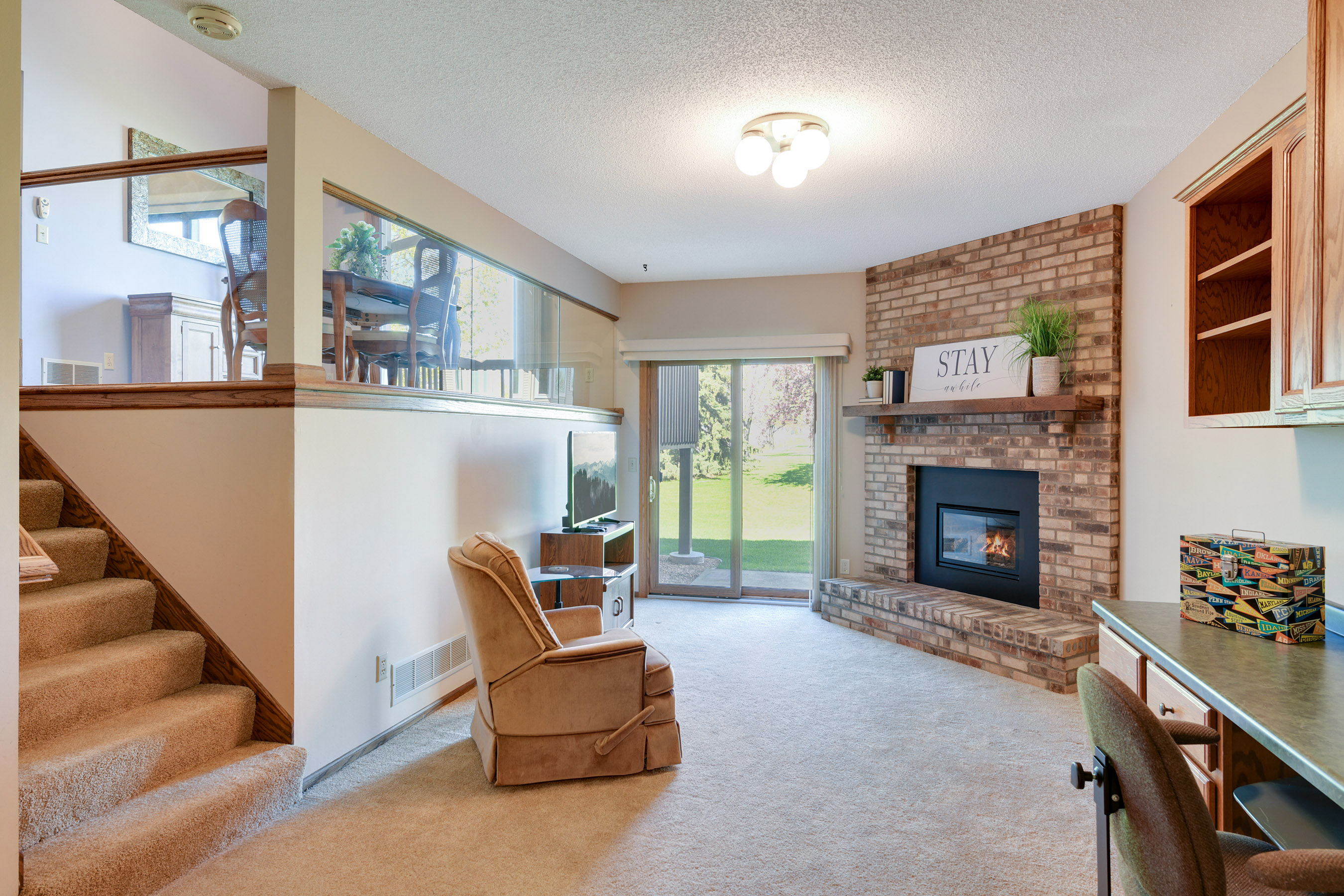 Beautiful brick gas fireplace in family room with great built ins.