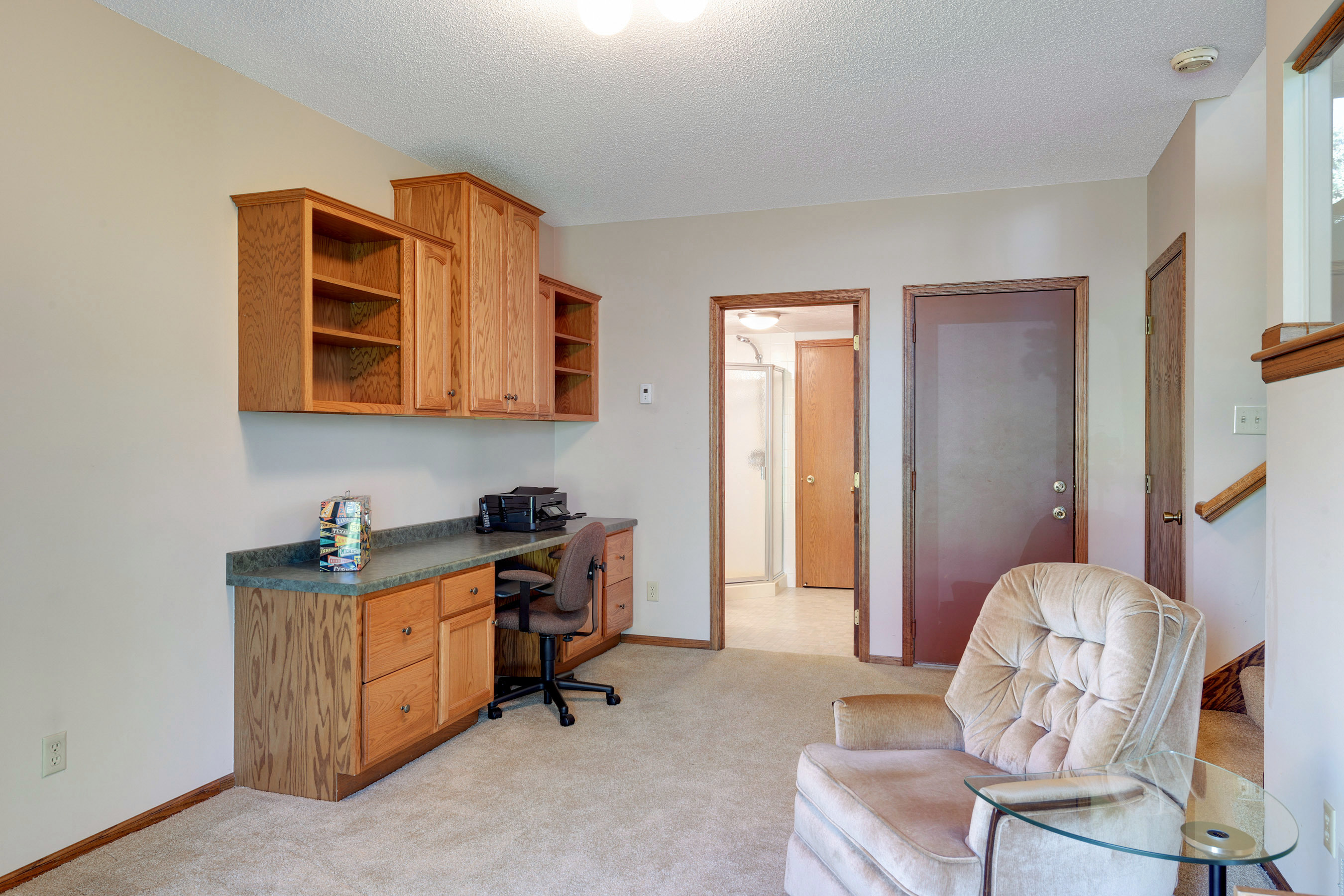 View of some of the built-ins,bathroom adjoins