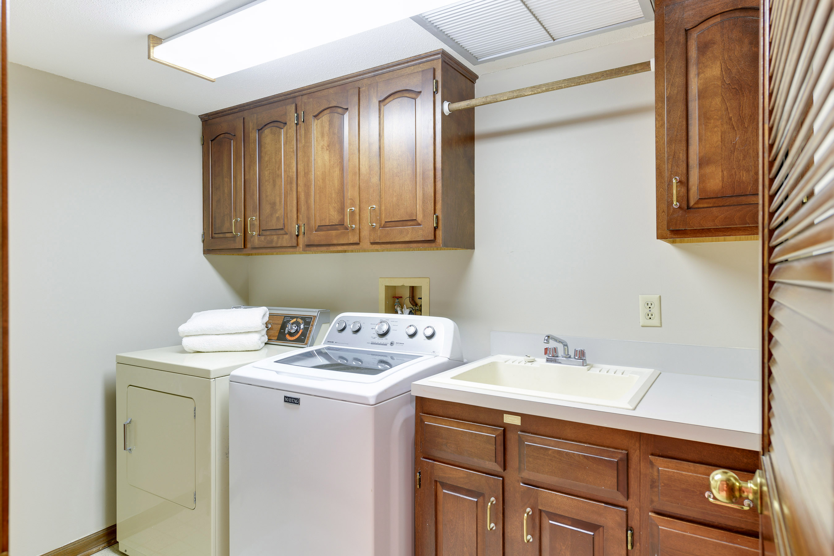 There is a main floor laundry with a wash tub and several built-in cabinets