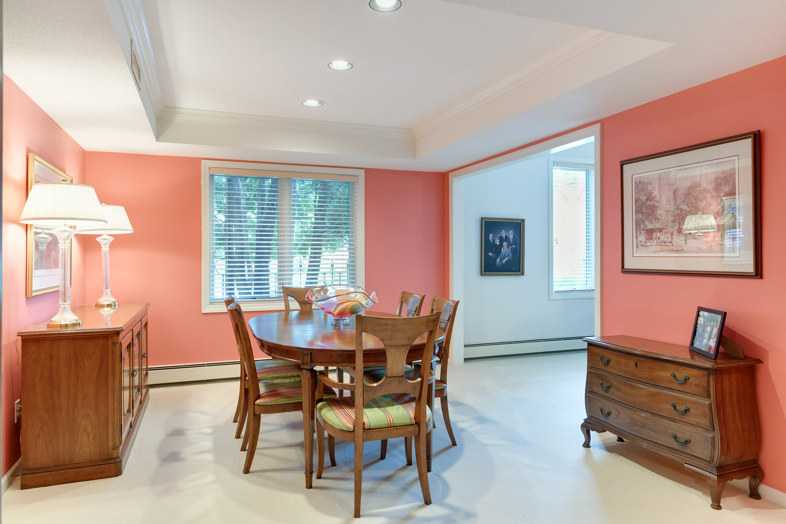 The spacious dining room has recessed lighting and crown molding